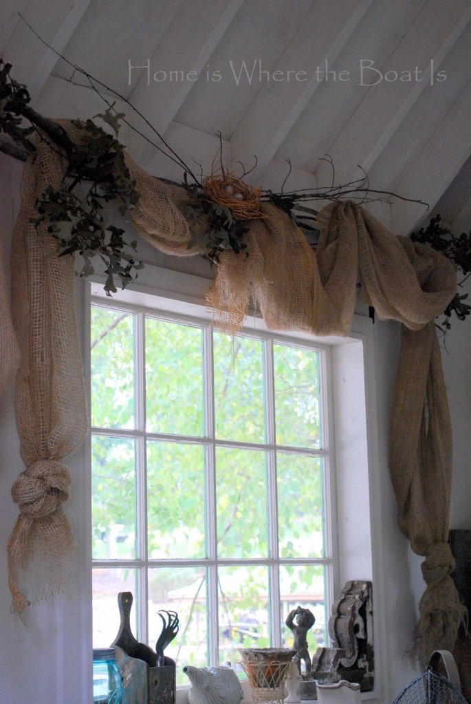 Window dressing for the Potting Shed with landscape burlap, twig rods and bird nest | ©homeiswheretheboatis.net #pottingshed #gardenshed #windows #nest #burlap