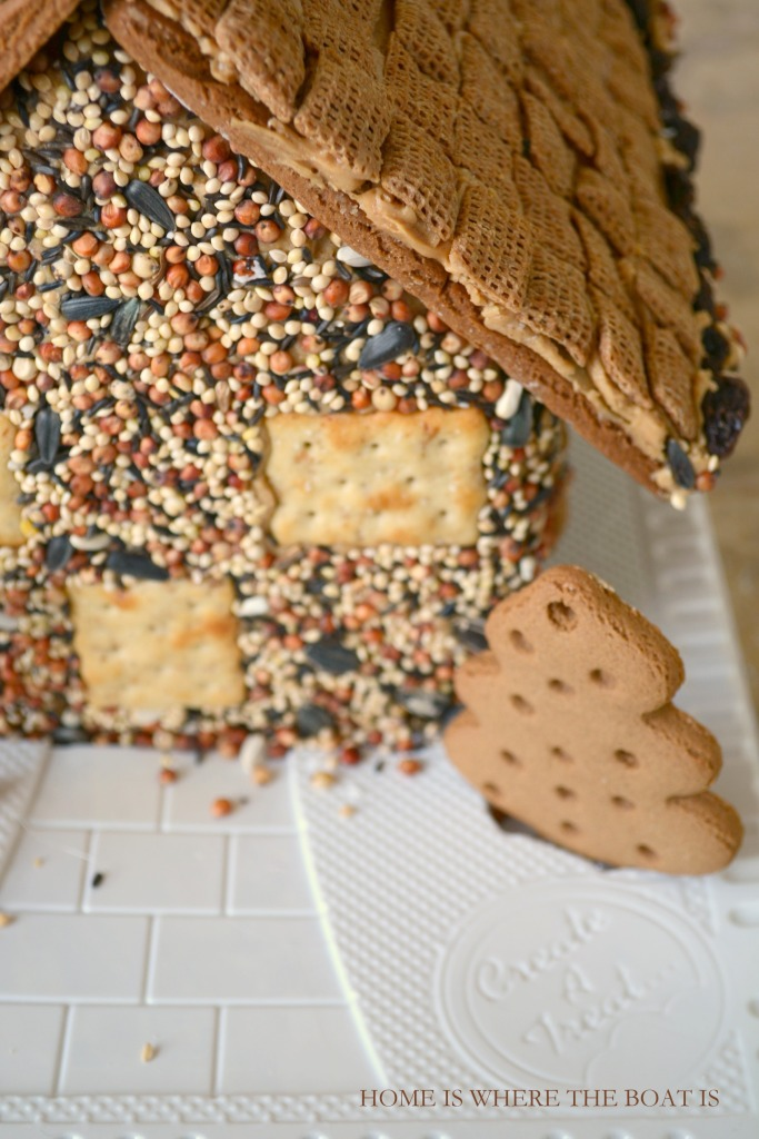 Gingerbread House Bird Feeder! Make an edible house for the birds, a fun activity with the kids using a gingerbread house kit from the grocery store! | homeiswheretheboatis.net #DIY #birdfeeder