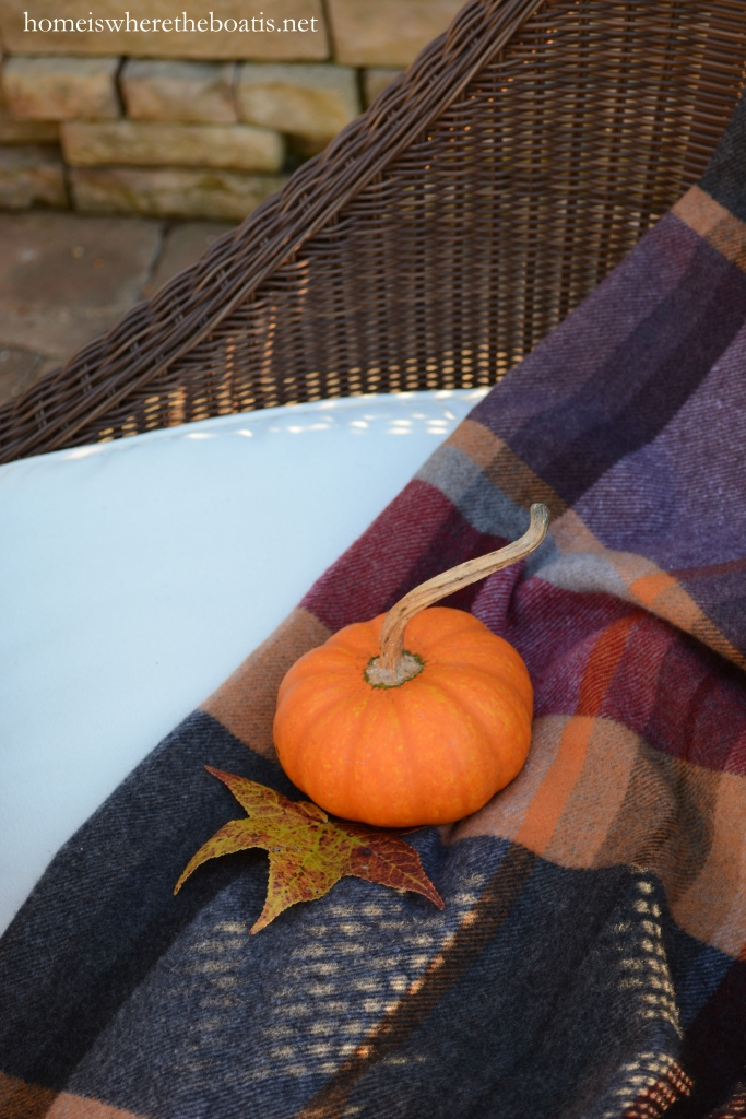 Giving Thanks Table With Warm Plaid Layers And Pumpkins