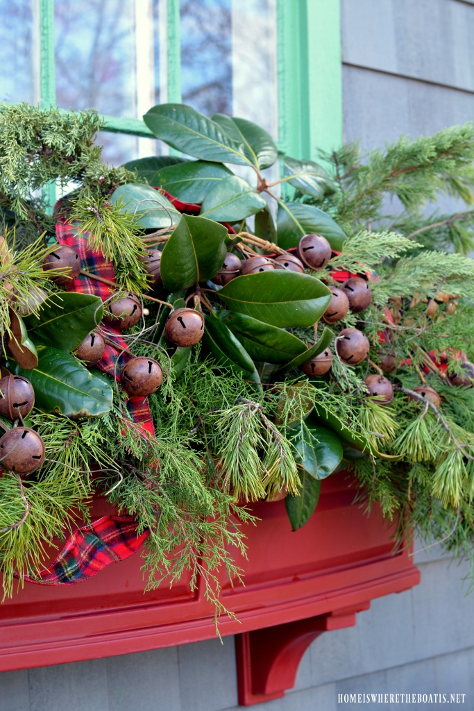 Christmas greenery in window boxes of Potting Shed | ©homeiswheretheboatis.net