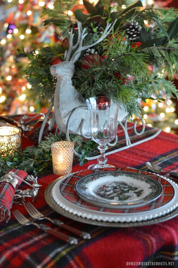 Reindeer sleigh tartan christmas table and centerpiece