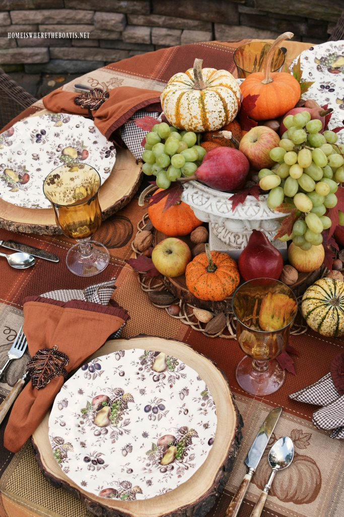 Autumn's Delight Alfresco Table with Harvest fruit and pumpkin centerpiece | ©homeiswheretheboatis.net #fall #tablescapes #alfresco