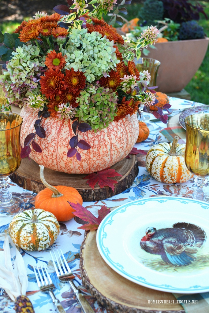 Alfresco thanksgiving table and blooming pumpkin