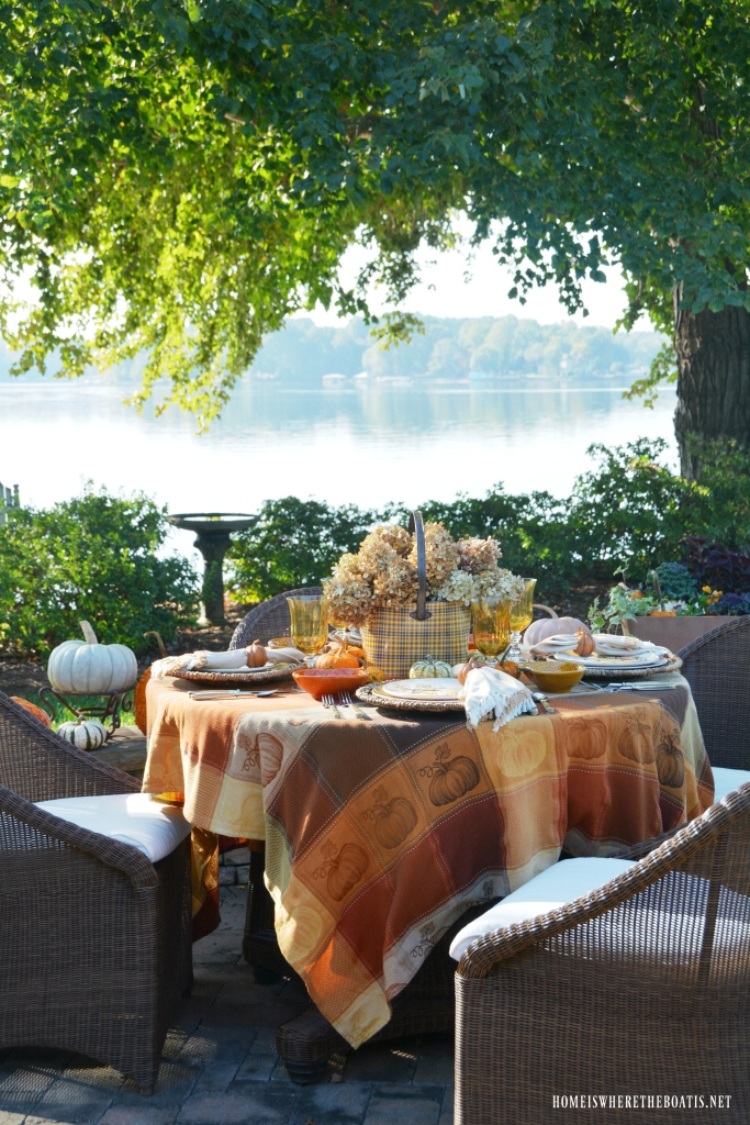 Pumpkins and Plaid Alfresco Fall Table by the lake | ©homeiswheretheboatis.net #fall #tablescapes #alfresco #pumpkins