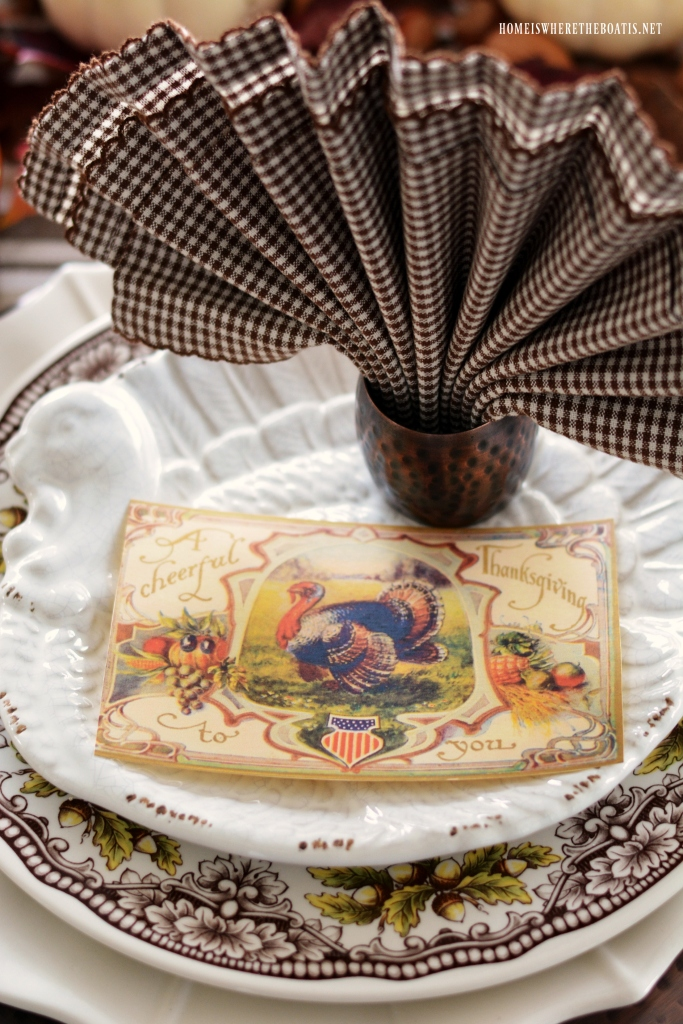Thanksgiving Table with Patriotic Vintage Thanksgiving Greetings Postcards and turkey fantail napkin fold | homeiswheretheboatis.net #Thanksgiving table #patriotic #postcard #tablescape