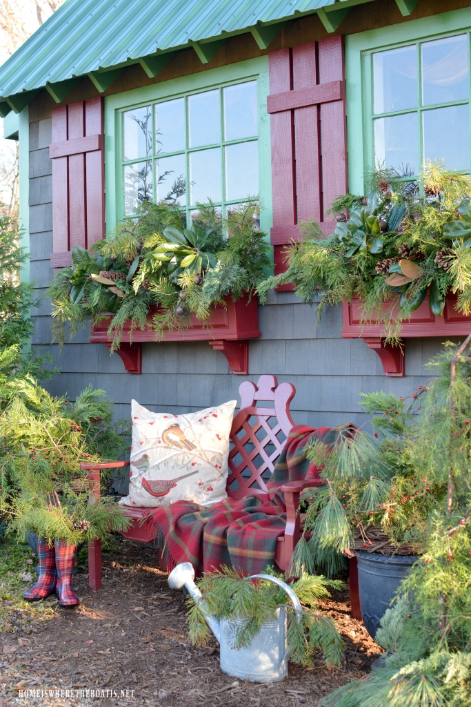 Greenery in Potting Shed window boxes for Christmas | ©homeiswheretheboatis.net