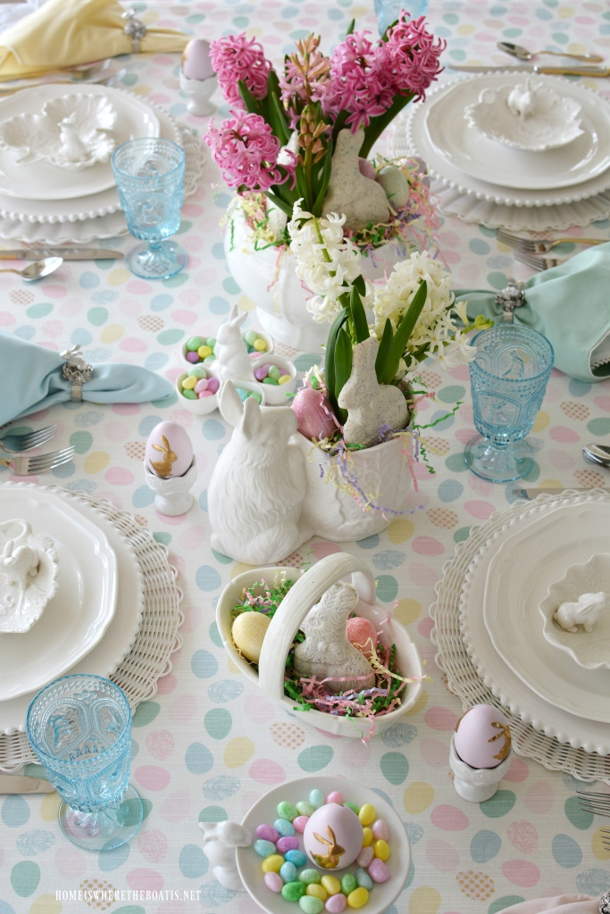 Easter table with pastels, eggs and bunnies | ©homeiswheretheboatis.net #easter #tablesetting #tablescapes #bunny