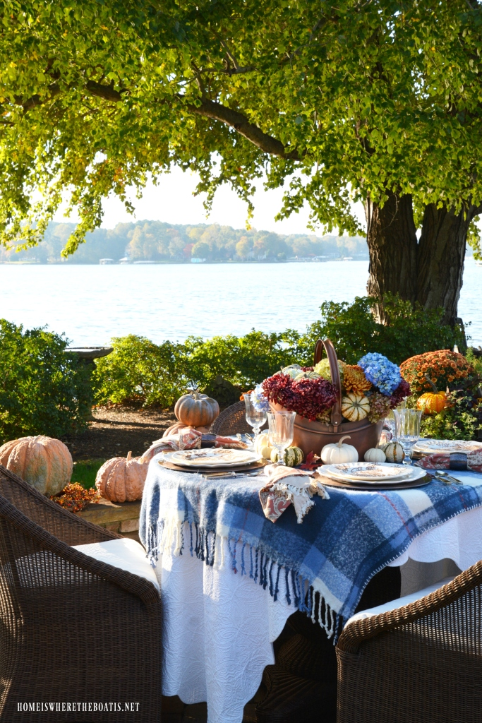 Lakeside fall table with a touch of blue and easy flower arranging method | ©homeiswheretheboatis.net #tablescape #fall #lake #tablescapes #pumpkins #alfresco