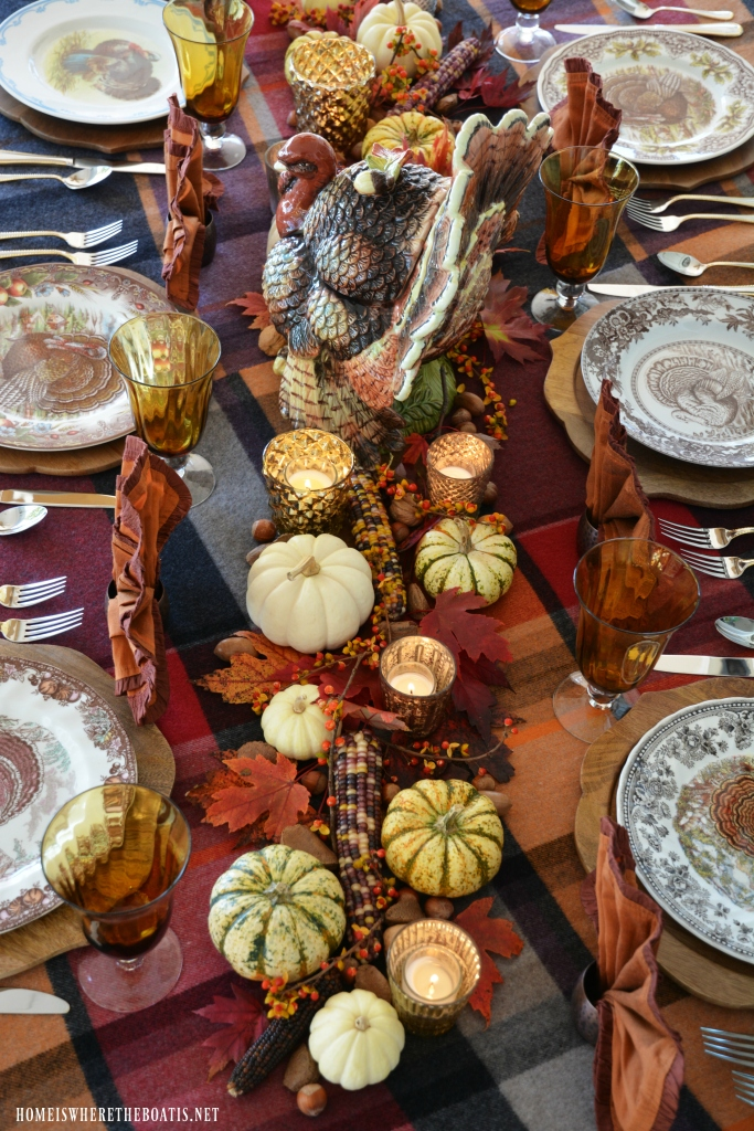 Thanksgiving table with assorted Tom Turkeys and turkey tureen centerpiece | ©homeiswheretheboatis.net #Thanksgiving #tablescape #tablesetting #turkey