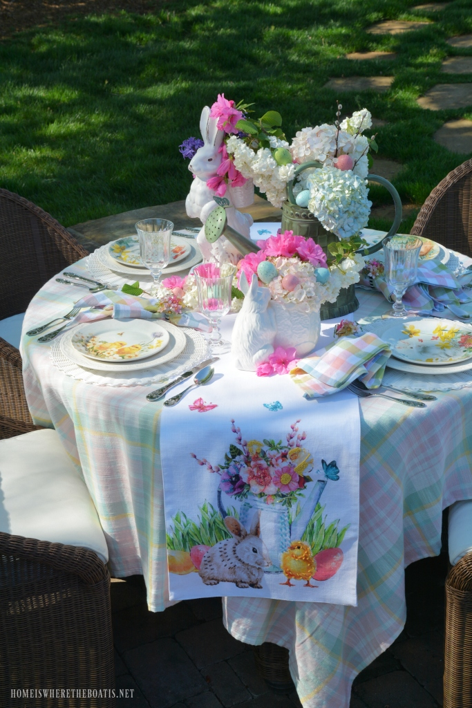 Alfresco spring table with blooming bunnies and watering can | ©homeiswheretheboatis.net #spring #tablescape #bunnies #easter