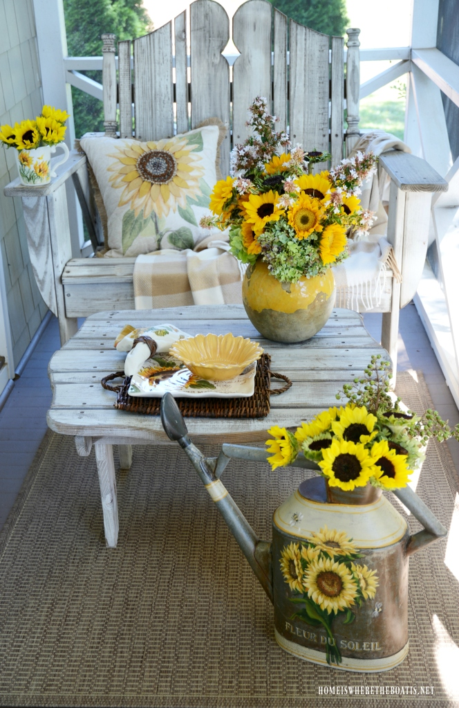 Sunflowers on the porch | ©homeiswheretheboatis.net #sunflowers