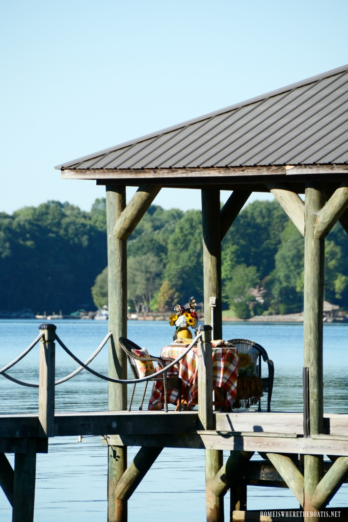 Dockside table with sunflowers | ©homeiswheretheboatis.net #sunflowers #lake #summer #alfresco