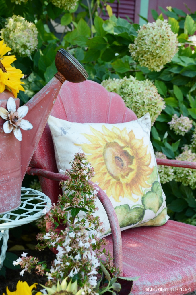 Vintage Lawn Chair with Sunflowers and Watering Can | ©homeiswheretheboatis.net #chalkpaint #DIY #sunflowers