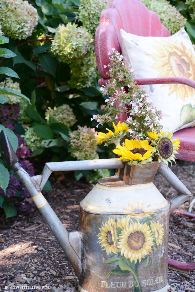 Vintage Lawn Chair with Sunflower Pillow and Watering Can | ©homeiswheretheboatis.net #chalkpaint #DIY