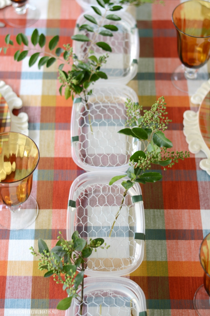 Create a DIY fresh flower table runner with chicken wire | ©homeiswheretheboatis.net #flowers #fall #centerpiece #tablescapes
