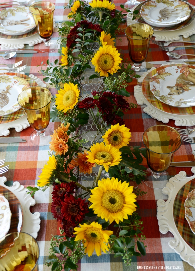 Create a DIY fresh flower table runner for fall | ©homeiswheretheboatis.net #flowers #fall #centerpiece #tablescapes