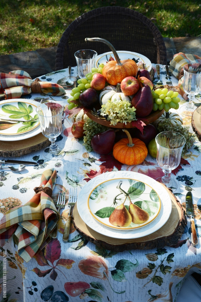 Alfresco botanical fall fruits tablescape | ©homeiswheretheboatis.net #tablescapes #fall #fruit #alfresco