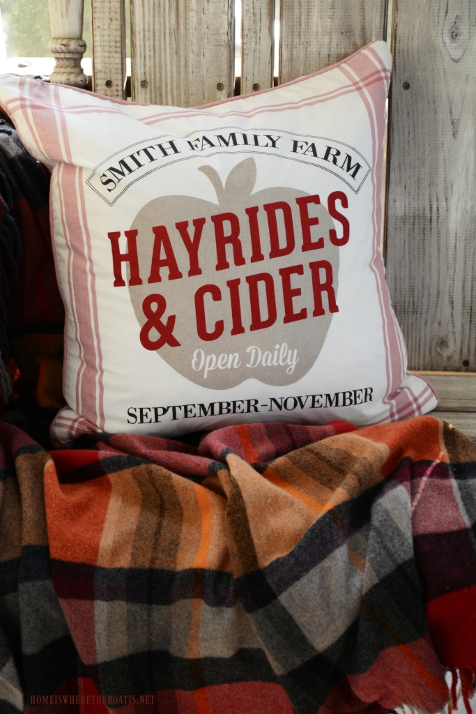 Hayrides and Cider Pillow and Apples on the Porch | ©homeiswheretheboatis.net #fall #porch #apples