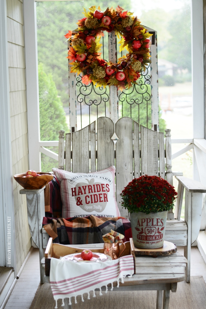 Apples on the Porch | ©homeiswheretheboatis.net #fall #porch #apples #wreath
