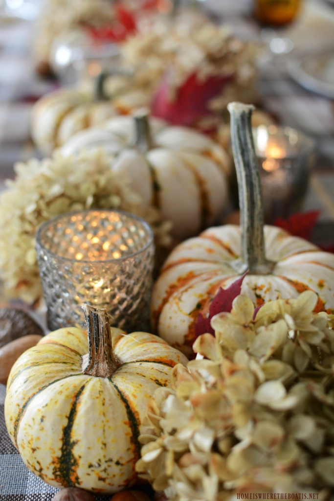 Easy and natural table runner centerpiece for fall or Thanksgiving | ©homeiswheretheboatis.net #thanksgiving #tablescapes #easy