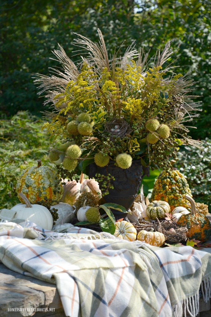 Fall vignette and arrangement with pumpkins, foliage, berries, pods and bird nest | ©homeiswheretheboatis.net #fall #arrangement