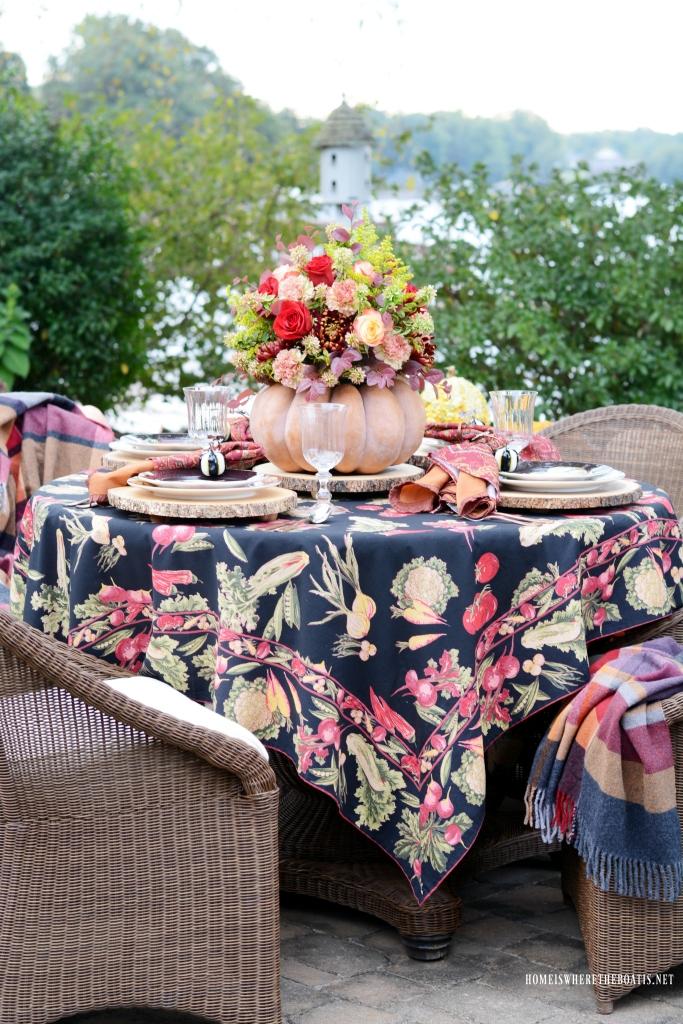 Autumn table with blooming pumpkin centerpiece   ©homeiswheretheboatis.net #fall #tablescapes #centerpiece #pumpkin