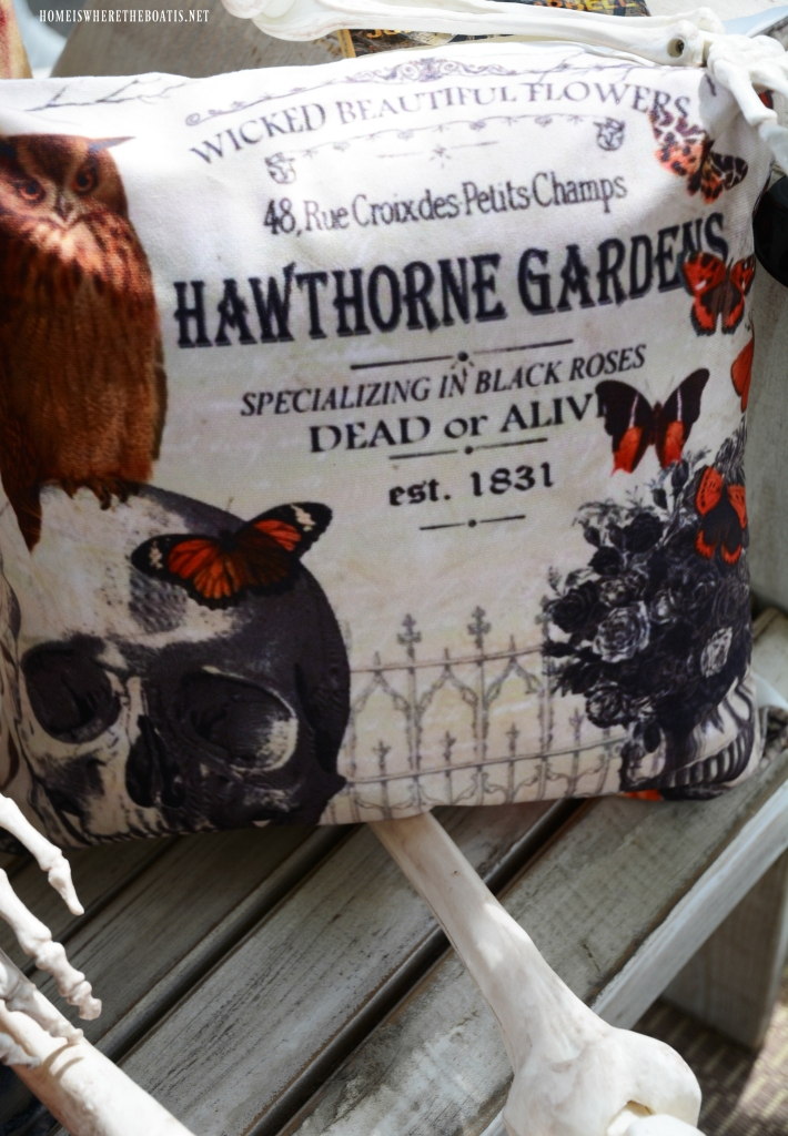 Hawthorne Gardens Wicked Beautiful Flowers Pillow | ©homeiswheretheboatis.net #halloween #porch #skeleton