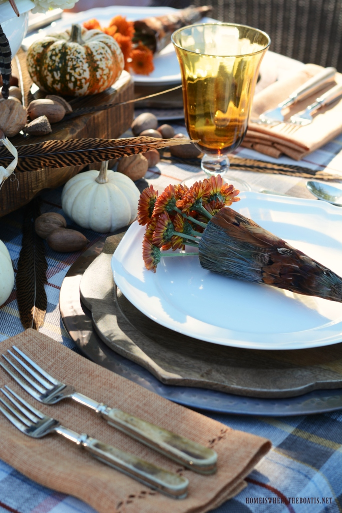 Feather cone tussie mussies with mums | ©homeiswheretheboatis.net #fall #tablescape