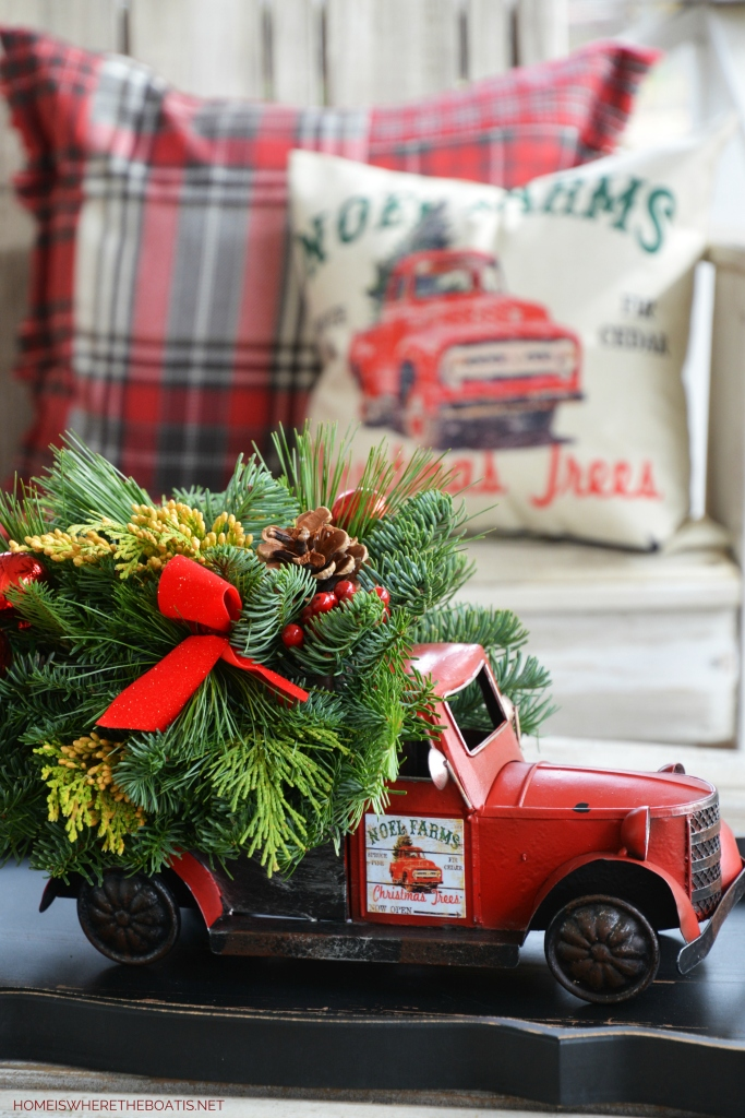 Noel Farms Christmas Truck Centerpiece with greenery | ©homeiswheretheboatis.net #christmas #truck #centerpiece
