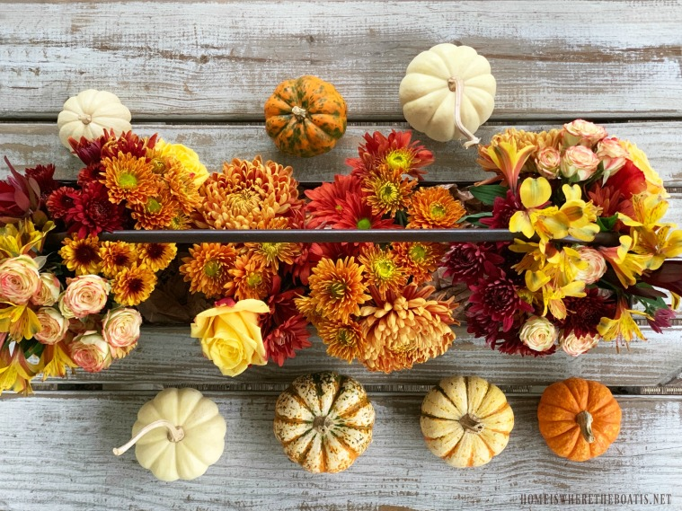 DIY fall floral centerpiece with pumpkins | ©homeiswheretheboatis.net #fall #autumn #DIY #flowerarranging