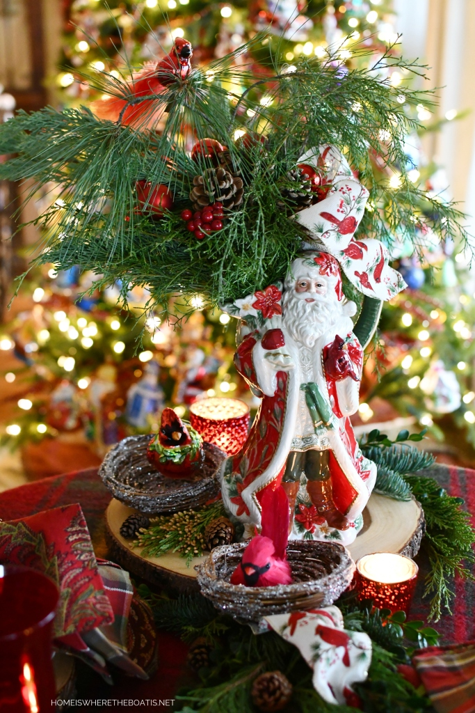 Cardinal Christmas Santa by Fitz and Floyd Centerpiece with greenery, pine cones and Cardinal ornament | ©homeiswheretheboatis.net #Christmas #tablescapes #Santa #birds #tartan #plaid