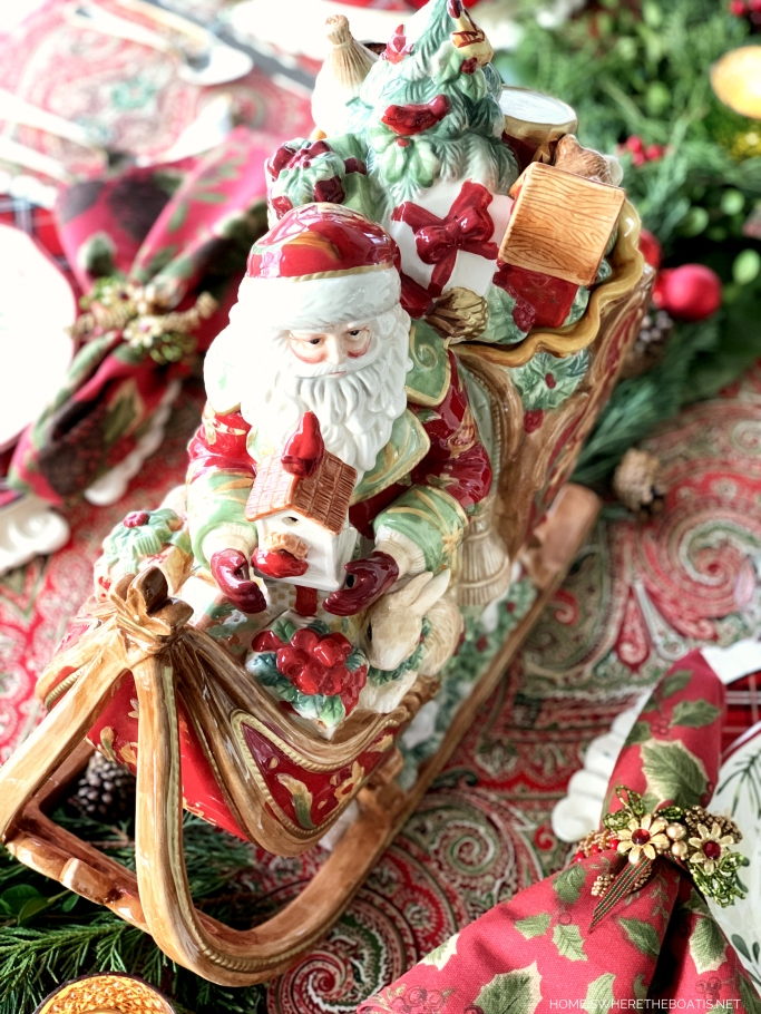 Fitz and Floyd St. Nicholas Sleigh Centerpiece and Christmas Table | ©homeiswheretheboatis.net #Christmas #tablescapes #redandgreen