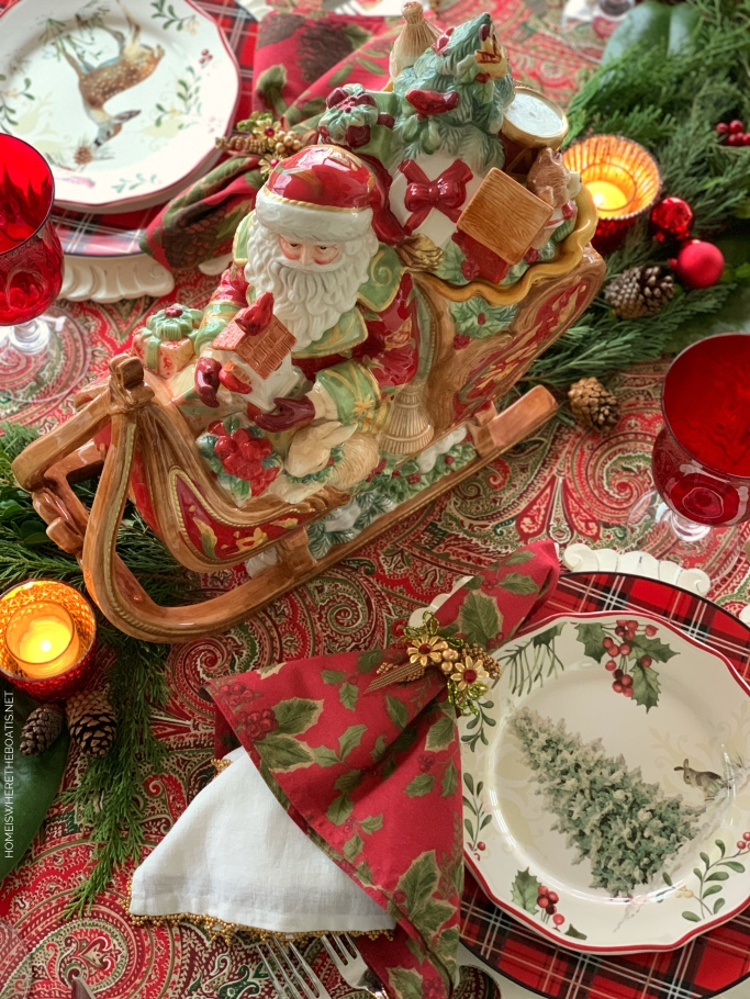 St. Nicholas Sleigh Centerpiece Christmas Table | ©homeiswheretheboatis.net #Christmas #tablescapes #redandgreen