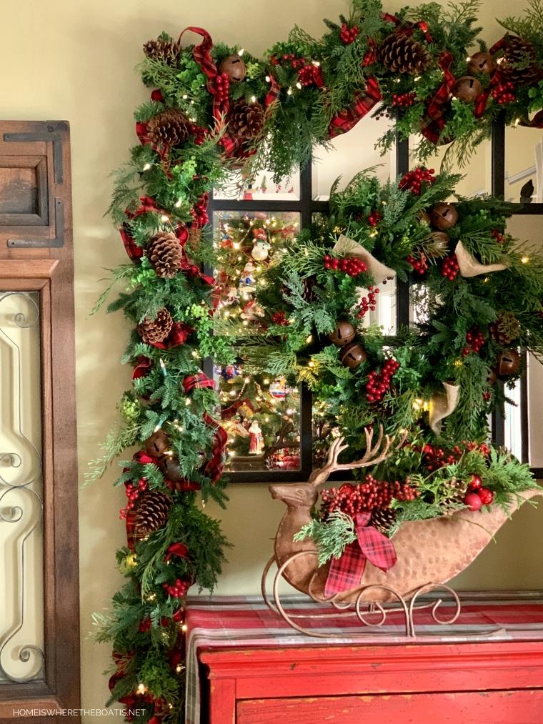 Christmas wreath and garland with berries, pine cones and tartan ribbon | ©homeiswheretheboatis.net #christmas #greenery #tartan