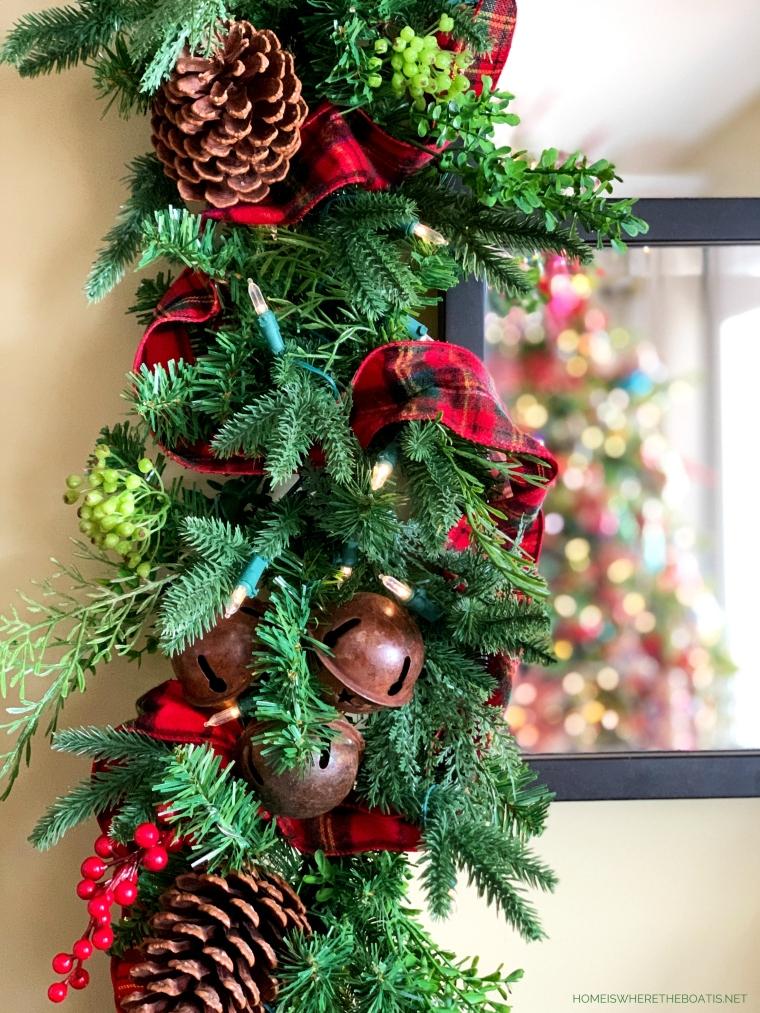 Christmas garland with rusty bells, berries, pine cones and tartan ribbon | ©homeiswheretheboatis.net #christmas #greenery #tartan