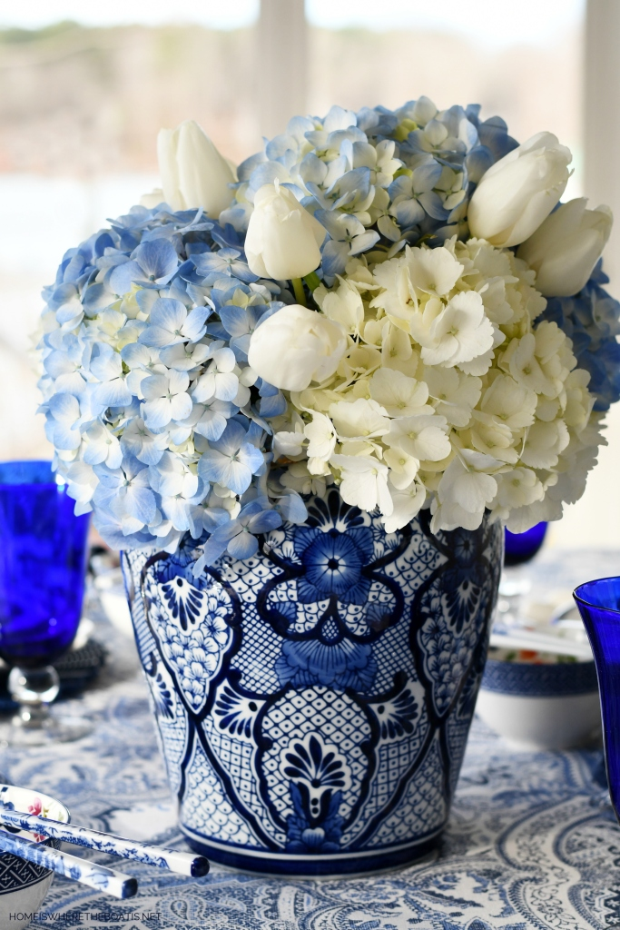 Blue and white ginger jar with hyrangeas and tulips | ©homeiswheretheboatis.net #tablescapes #chinesenewyear #blueandwhite