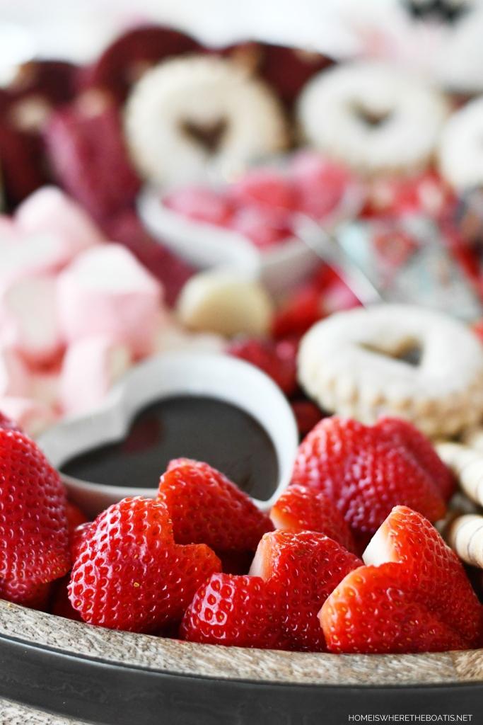 Heart-Shaped Strawberries and Valentine's Day Dessert Board | ©homeiswheretheboatis.net #valentinesday #dessert #board #chocolate