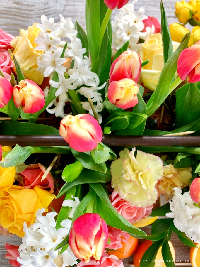 DIY Floral Arrangement with Tulips, Roses, Hyacinths, Carnations and Citrus | ©homeiswheretheboatis.net #flowers #centerpiece #DIY