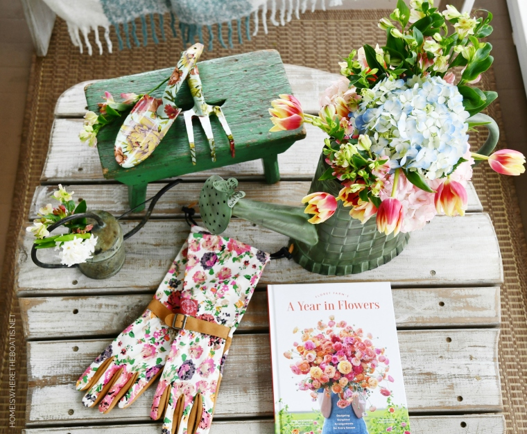 Spring on the porch and flowers in watering can | ©homeiswheretheboatis.net #flowers #spring