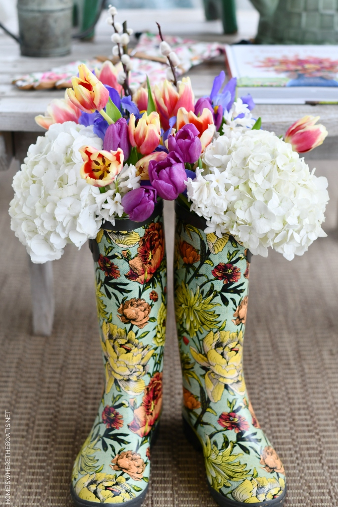 Wellies with flowers | ©homeiswheretheboatis.net #flowers #wellies #spring