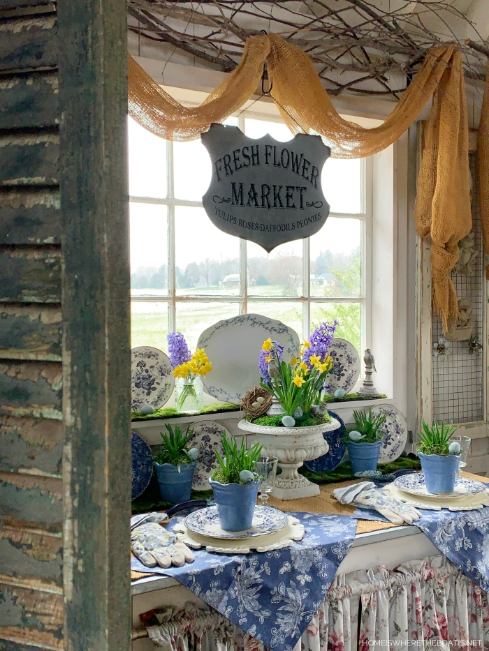 Spring blooms in Potting Shed | ©homeiswheretheboatis.net #spring #flowers #tablescapes