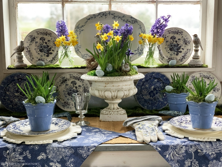 Blue and white garden table in Potting Shed | ©homeiswheretheboatis.net #spring #flowers